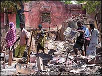 Somalis search the debris of their homes in the capital, Mogadishu