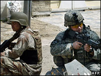 A US and an Iraqi soldier on patrol in Baghdad on 17 April