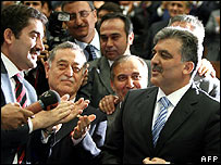 Abdullah Gul (right) is congratulated by lawmakers in Ankara
