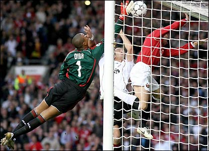 Dida puts the ball into his own net