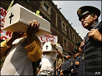 Anti-abortion activists carry baby coffins during a protest in Mexico City