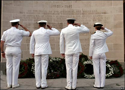 Representatives from the Australian and New Zealand navies lay wreaths at a dawn service in Singapore