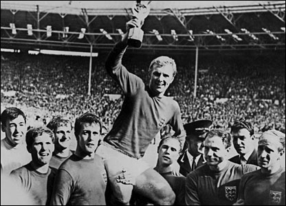Ball (front left) and team-mates hoist team captain Bobby Moore aloft after winning the World Cup