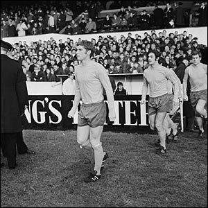 Everton players Alan Ball, Jimmy Husband and Joe Royle run onto the pitch