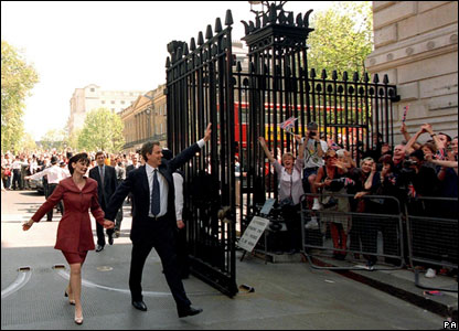 Prime Minister Tony Blair and his wife, Cherie, walking hand-in-hand into Downing Street in 1997