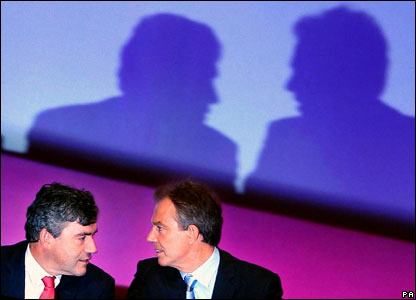 Tony Blair and Gordon Brown talk during Bono's speech to the Labour Party Conference, 2004