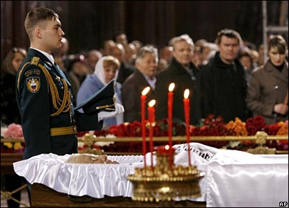 A soldier stands next to Mr Yeltsin's open coffin as mourners look on