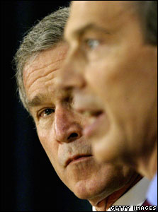 US President George W. Bush (L) listens as British Prime Minister Tony Blair answers a question during their joint press conference