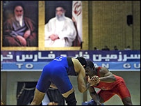 US freestyle wrestler Anthony Ramico Blackmon (R) and Iran's Hamid Razani compete during the Iranian Takhti international wrestling tournament in the Gulf port city of Bandar Abbas, 1,300 kms southeast
