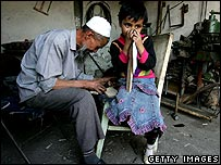 A man and his granddaughter in Xinjiang, home to a large population of Uighurs (file photo)