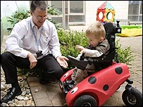 Photo of a boy using the Wizzybug