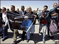 Palestinian and foreign journalists hold posters of kidnapped BBC correspondent Alan Johnston during a protest demanding his release at the Erez crossing between Israel and the Gaza Strip