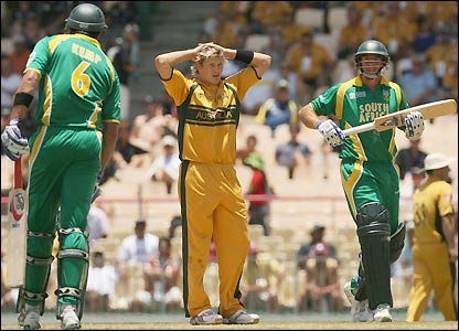 Shane Watson holds his head as South Africa's tail frustrate