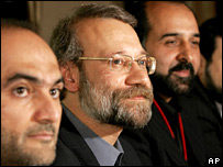 Ali Larijani (centre) flanked by Iranian officials