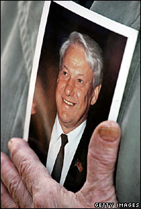 Mourner holding portrait of Boris Yeltsin at his funeral in April 2007