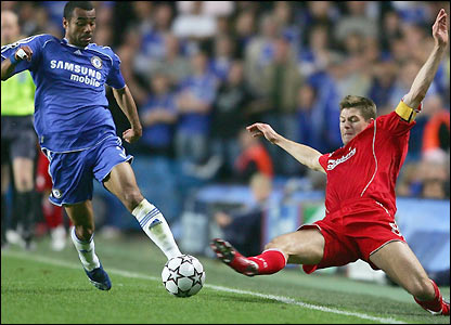 Ashley Cole is tackled by Steven Gerrard