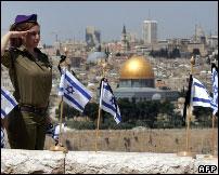 Israel soldier marks Independence Day overlooking East Jerusalem