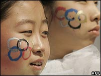 Chinese dancers with Olympic rings on their faces (file photo)