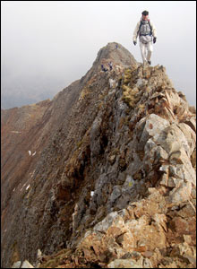 Richard stepping out onto the main crossing of Crib Goch while walking the Snowdon Horseshoe (Ian Morris)