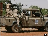 Gunmen in Um Shalaya