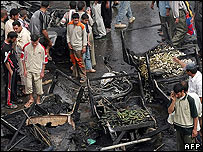The aftermath of a bombing in an Iraqi market