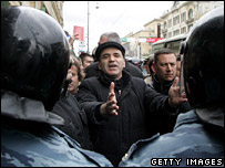 Garry Kasparov raises his hands in front of riot police during a protest against Vladimir Putin on 14 April 2007