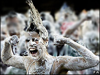 Students covered in shaving foam for 'Raisin Weekend' at St Andrews University, Fire