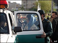 Iranian woman being arrested