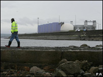 Scottish Water employee examining the outflow pipe on Seafield Beach