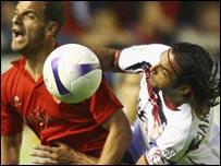 Roberto Soldado (left) is challenged by Javi Navarro
