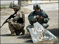 Iraqi and US soldier on patrol in Baghdad