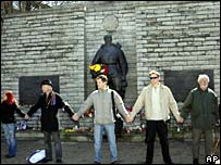 Protesters link arms around Red Army monument