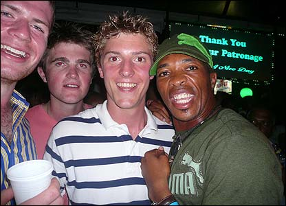 Patrick meets South Africa's Makhaya Ntini at Palm Court in Georgetown as the side drown their sorrows