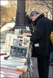 Man browing at open air bookstall in Paris