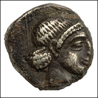 A silver coin depicting a human head, from the 4th Century BC (Photo: Chaman atelier multimedia, S. Crettenand)