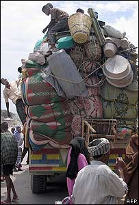 Somali residents of Mogadishu pile their belongings onto a cargo truck