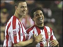 Jonny Evans (left) congratulates Sunderland match-winner Carlos Edwards