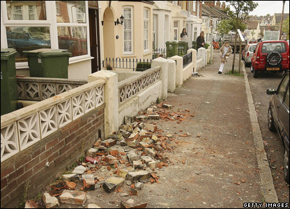Bricks and debris on a street in Folkestone, Kent
