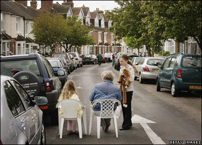 Residents of Folkestone sit in the street