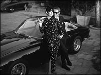 Steve McQueen with model Peggy Moffit