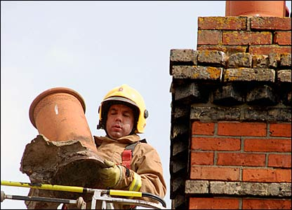Firefighter removes damaged chimney stack in Folkestone