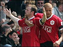 Wayne Rooney (left) scored United's third goal