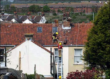 Kent firefighters remove dangerous chimney stack