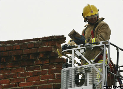 Firefighter by crumbling chimney in Folkestone, Kent