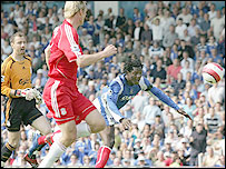 Pompey striker Benjani Mwaruwari nods in after a mistake by Liverpool keeper Jerzy Dudek