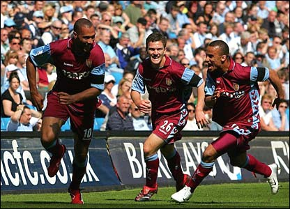John Carew (l) celebrates his goal for Aston Villa