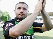 A disconsolate Ben Cohen salutes the Saints fans as he leaves the field