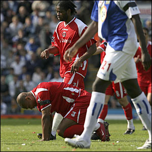 Charlton goalscorer Darren Bent is despondent at the final whistle
