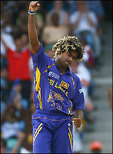 Malinga punches the air after taking the first wicket of the day