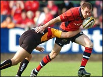 Barry Murphy is tackled by Aled Thomas